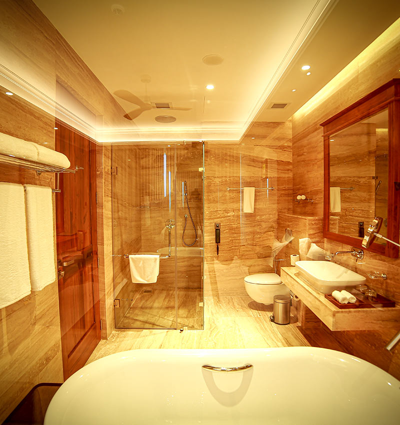 Spacious and well-equipped bathroom of studio room