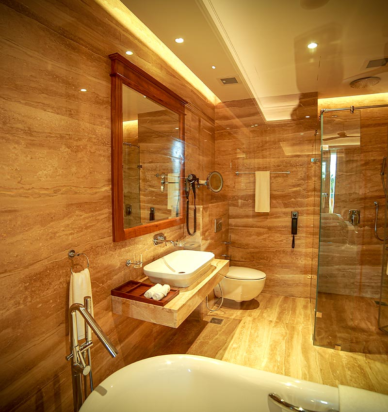 Spacious and well equipped deluxe room bathroom