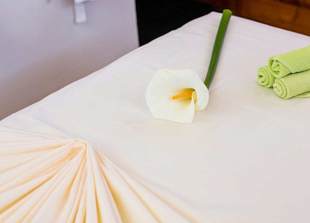 Spa Bed and a White Flower