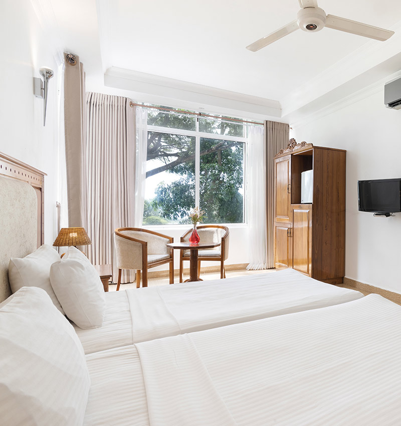 Comfy twin bed at Deluxe Room of Hotel Sudu Araliya